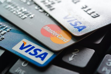 Stock Photo - Group of credit cards on computer keyboard with VISA and MasterCard brand logos