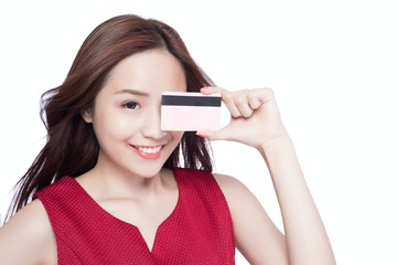 Stock Photo - woman shows her credit card ,asia beauty