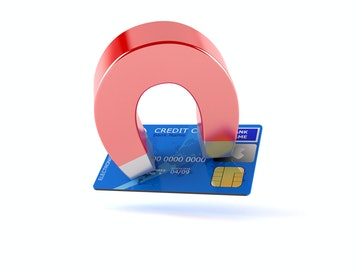 Stock Photo - Magnet with credit card isolated on white background