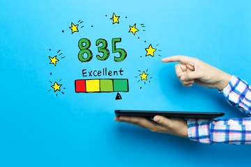 Stock Photo - Excellent credit score theme with a tablet computer on a blue background
